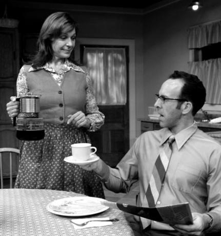 woman pouring coffee for husband in 70s-style kitchen