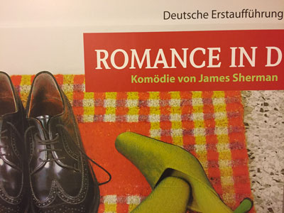 men's black shoes, women's green high heels, and text reading Romance in D